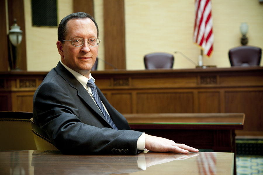 Personal Injury Lawyer Christopher MacNeil sitting in an Oregon State Courtroom