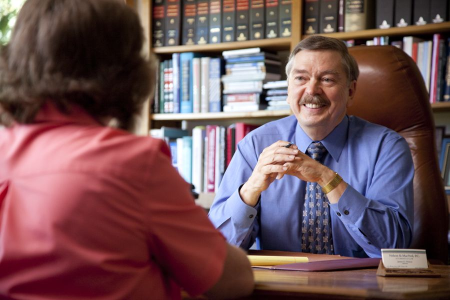 Client speaks with Oregon personal injury attorney Jim Nelson, who listens attentively.